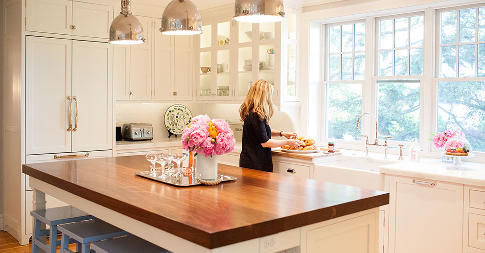 a kitchen in hingham ma outfitted with lighting and accessories purchased in the delicious designs